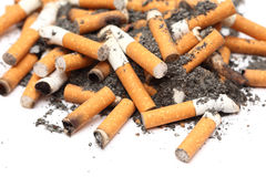Cigarette Butts. Heap on white background. Unhealthy habit. Close-up Royalty Free Stock Photos