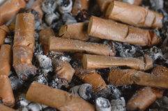 Cigarette butts. Many cigarette butts in the ashtray piled Stock Photography