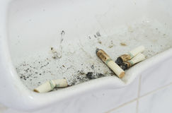 Cigarette butts. Many cigarette butts close up in ash receiver Stock Photos