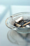 Cigarette butts and matches Royalty Free Stock Photos