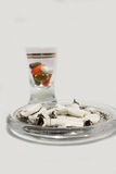 Cigarette butts and pills in glass Royalty Free Stock Photo
