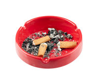 Cigarette butts in red plastic ashtray Royalty Free Stock Photography