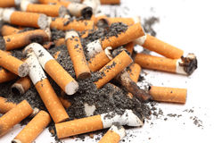 Cigarette Butts. On white background. Unhealthy habit. Close-up stock images