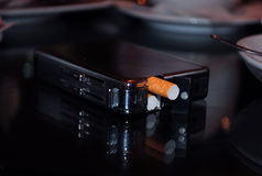 Cigarette case. Metal cigarette box lying on the table, smoking, unhealthy product, close-up Stock Photo