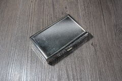 cigarette case on an old wooden table Royalty Free Stock Images