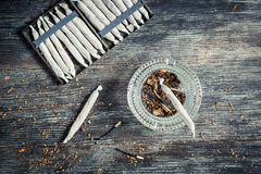 Cigarette cases full of cigarettes, lighter and ashtray Stock Image