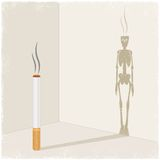 Cigarette casting shadow of skeleton Royalty Free Stock Photo