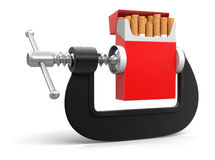 Cigarette in clamp (clipping path included) Royalty Free Stock Image