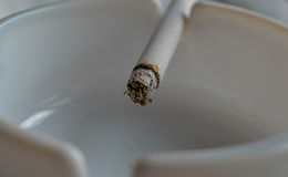 Cigarette. Close up on a cigarette on an ashtray Stock Photography