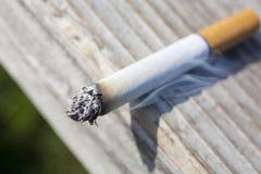 Cigarette. A close up of a lit tobacco cigarette Stock Image