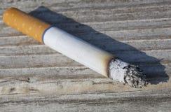 Cigarette. A close up of a lit tobacco cigarette Stock Photos