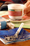 Cigarette and Coffee. Cigarette on an ashtray when Coffee Royalty Free Stock Photography
