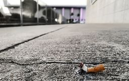 A cigarette on the floor. A cigarette on the concrete floor royalty free stock images