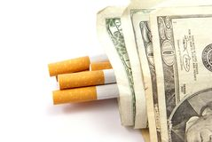 Cigarette Costs. Healthcare and Health insurance cost concept, or high cost of cigarettes. Cigarettes with money Royalty Free Stock Photo