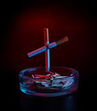 Cigarette cross on ashtray Stock Image