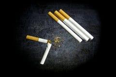Cigarette. Crumpled cigarette tobacco and cigarette direct stock photos
