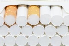 Cigarette dans la boîte Photo libre de droits