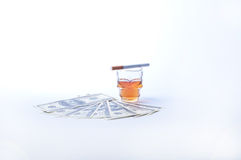 Cigarette dollars and whisky Stock Photo