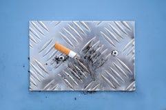 Cigarette End on Cigarette Stubbing Plate Stock Photos