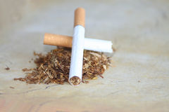Cigarette end and fist stock image