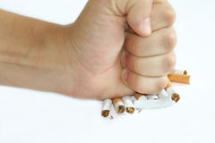 Cigarette end and fist Stock Photography