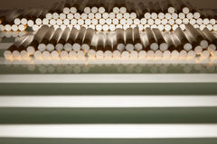 Cigarette filters prepared for filling Royalty Free Stock Images