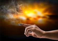 Cigarette on finger Royalty Free Stock Photo