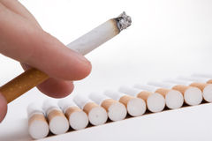 Cigarette in a fingers Stock Image