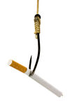 Cigarette in fishhook concept Stock Images