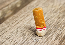 Cigarette on the floor Royalty Free Stock Photo
