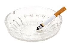 Cigarette in glass ashtray Royalty Free Stock Photography