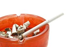 Cigarette in glass ashtray Royalty Free Stock Photos