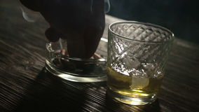 Cigarette And Glass Of Whiskey On The Table stock footage