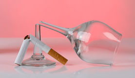 Cigarette and glasses Royalty Free Stock Images