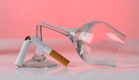 Cigarette and glasses. Color photo of broken cigarette and glasses Royalty Free Stock Images