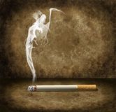 Cigarette and grim reaper smoke. Danger of cigarette with grim reaper smoke Royalty Free Stock Photography