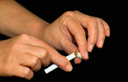 Cigarette and  hand. Hands of a cigarette break Royalty Free Stock Image
