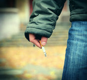 Cigarette in a Hand Stock Photo