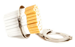 Cigarette  and  handcuffs Royalty Free Stock Photos