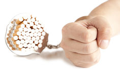 Cigarette  and  handcuffs Stock Photo