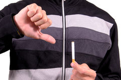 Cigarette. Hands turning down a cigarette Royalty Free Stock Image