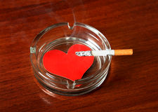 Cigarette with the Heart Shape Royalty Free Stock Photos