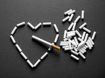 Cigarette in the heart Royalty Free Stock Images