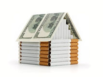 The cigarette house and souvenir dollars Royalty Free Stock Image