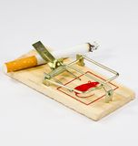 Cigarette ignited in trap for mouse. Mousehole with cigarette ignited on white background Royalty Free Stock Photo