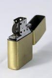 Cigarette lighter. A near racket metal cigarette lighter Royalty Free Stock Photo