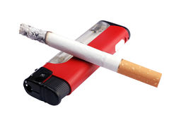 Cigarette with lighter. Cigarette  simply laying down on the lighter Royalty Free Stock Images