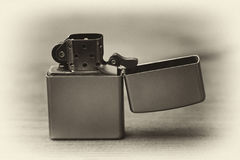 The cigarette lighter. Retro style Stock Photography