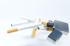 Cigarette and lighter on white background Royalty Free Stock Photos