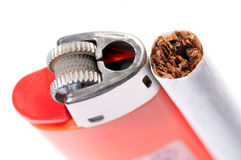 Cigarette and lighter on white background Royalty Free Stock Photo